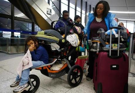 Muli Klarman, at Logan International Airport in Boston, had her flight home to Washington with her two children delayed on Saturday and again Sunday.